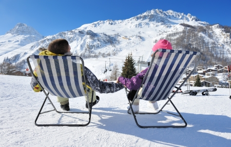 Couple at mountains in winter, Val-dIsere, Alps, France