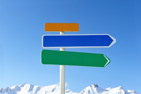 Arrow sign at mountains with snow in winter, Val-d'Isere, Alps, France Stock Photo - 13705698