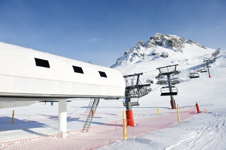 Ski lift station in mountains at winter, Val-dIsere, Alps, France photo