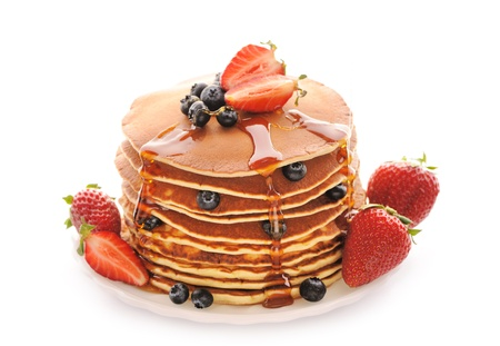 pancakes: Delicious freshly prepared pancakes with strawberry and blueberries isolated on white