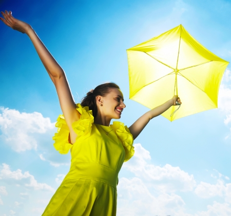 sun umbrella: Woman holding umbrella against sun and sky