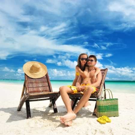 Couple on a tropical beach Stock Photo - 14133512