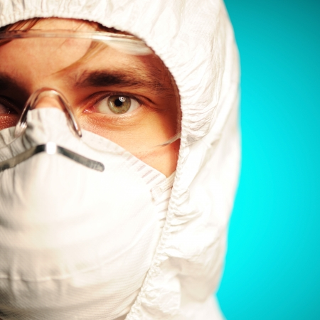 respirator: Scientist in protective wear, glasses and respirator