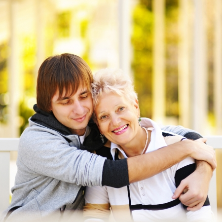 Aging woman: Mother and son having a hug Stock Photo