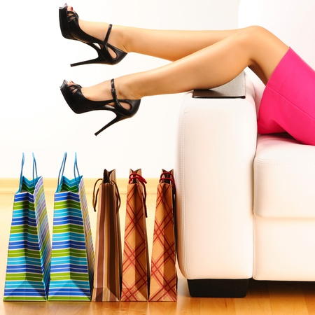 beautiful legs: Womans legs and shopping bags  Stock Photo