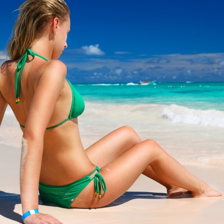 Bikini girl on caribbean beach photo