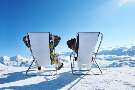 Couple at mountains in winter, Val-dIsere, Alps, France photo