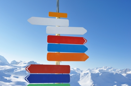 Arrow sign at mountains with snow in winter, Val-dIsere, Alps, France photo