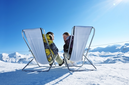 outdoor chair: Couple at mountains in winter, Val-dIsere, Alps, France