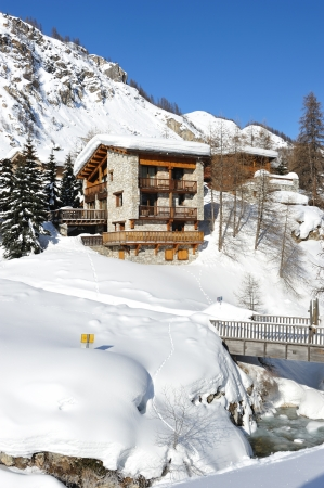 chalets: Mountain ski resort with snow in winter, Val-dIsere, Alps, France