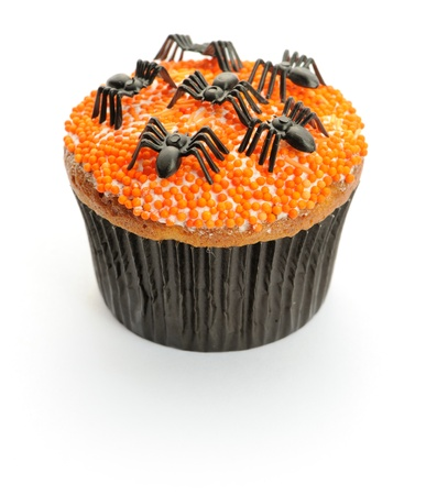 butter icing: Halloween cupcake with decoration isolated on white
