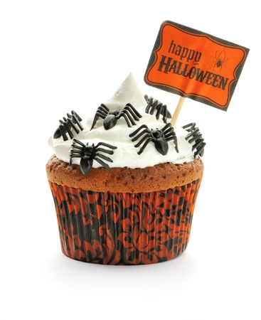 butter icing: Halloween cupcake with whipped cream and decoration isolated on white