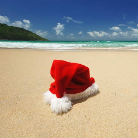 Santa's hat on a tropical beach photo
