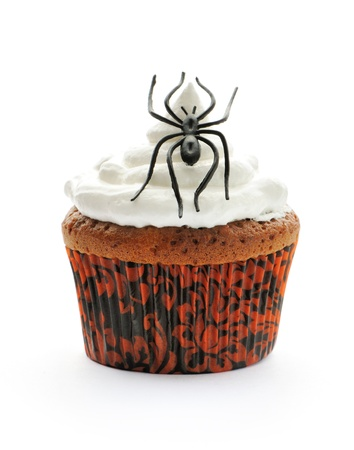Halloween cupcake with decoration isolated on white photo