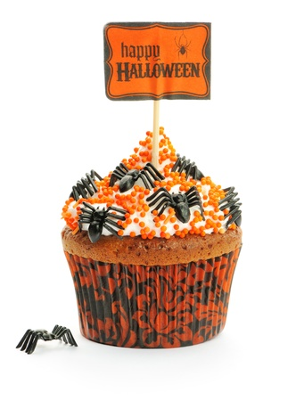 trick or treat: Halloween cupcake with decoration isolated on white