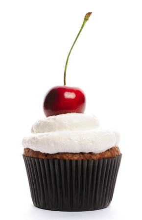 birthday cupcake: Cupcake with whipped cream and cherry isolated on white Stock Photo