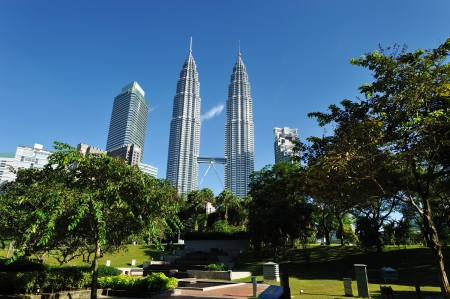 KUALA LUMPUR, MALAYSIA - AUGUST 24  Petronas Twin Towers at day on August 24, 2012 in Kuala Lumpur  Petronas Twin Towers  were the tallest buildings  452 m  in the world from 1998 to 2004