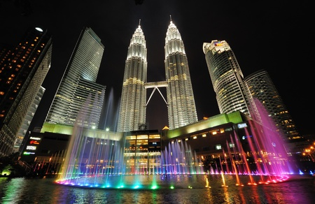 KUALA LUMPUR, MALAYSIA - AUGUST 31  Petronas Twin Towers at night on August 31, 2012 in Kuala Lumpur  Petronas Twin Towers  were the tallest buildings  452 m  in the world from 1998 to 2004