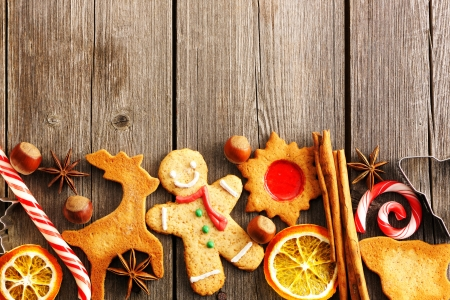Christmas homemade gingerbread cookies over wooden table Stock Photo - 16040970