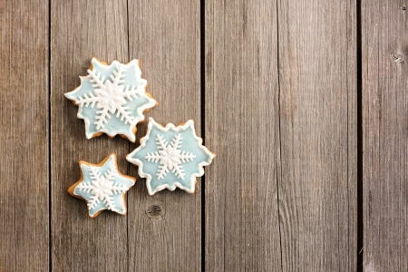 winter background: Christmas homemade gingerbread cookie over wooden table