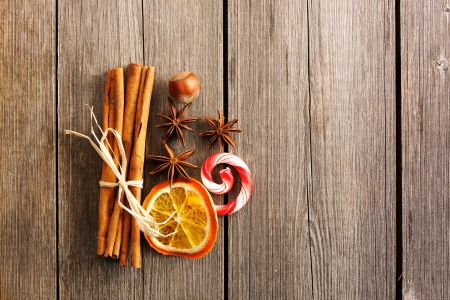 cinnamon: Cinnamon sticks and other spices over wooden table Stock Photo