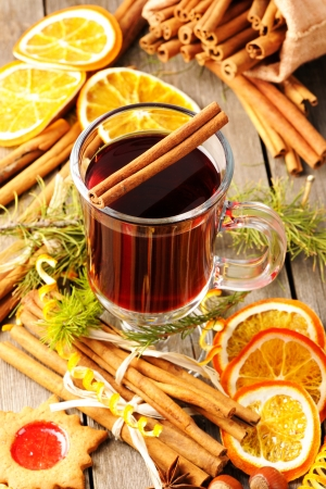 Glass of red mulled wine on wooden table Stock Photo - 16040923