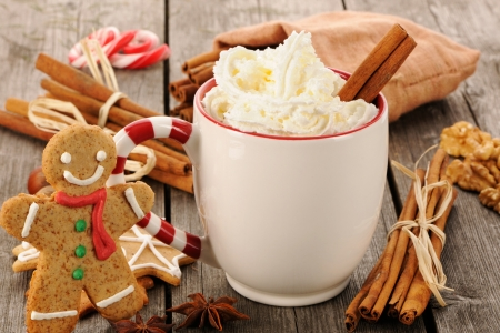 gingerbread man: Mug of hot chocolate on wooden table