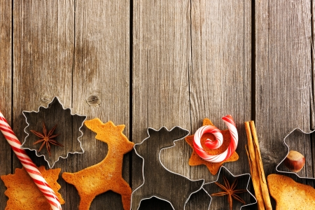 Christmas homemade gingerbread cookies over wooden table Stock Photo - 16235200