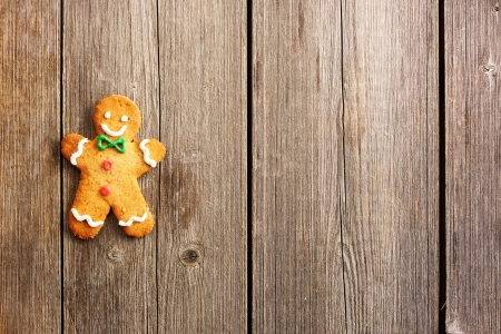 Christmas homemade gingerbread man over wooden table photo