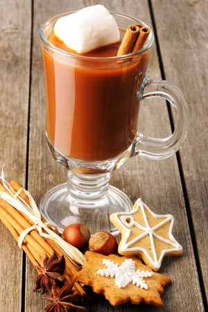 Glass of hot chocolate on wooden table photo