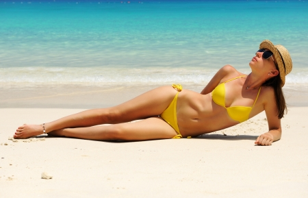 Woman in bikini at tropical beach Stock Photo