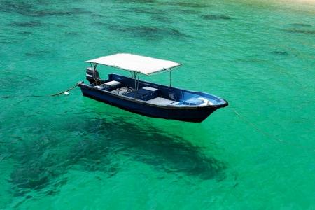 Beautiful beach with motor boat at Tioman island, Malaysia photo