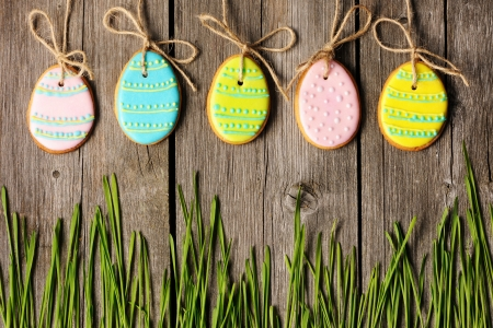 easter decorations: Easter homemade gingerbread cookie over wooden table