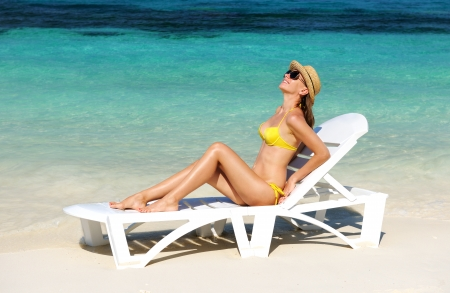 Girl on a tropical beach with hat Stock Photo - 17303023