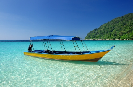 speedboat: Beautiful beach with motor boat at Perhentian islands, Malaysia Stock Photo