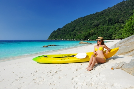 Woman in sunglasses at beach wearing hat and kayak Stock Photo - 17303070