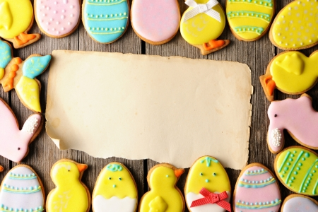 Easter homemade gingerbread cookie over wooden table photo