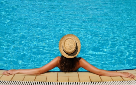 Woman in hat relaxing at the pool Stock Photo - 17667870