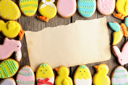 easter chick: Easter homemade gingerbread cookie over wooden table