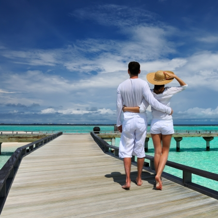 south beach: Couple on a tropical beach jetty at Maldives Stock Photo
