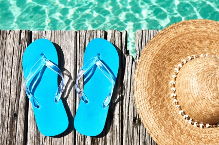 Slippers and hat at jetty by the sea Stock Photo - 18168802