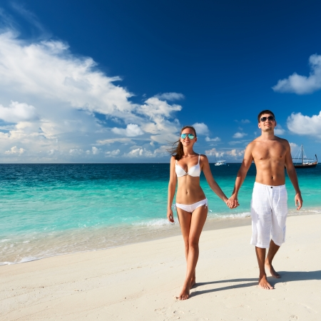 guy on beach: Couple on a tropical beach at Maldives