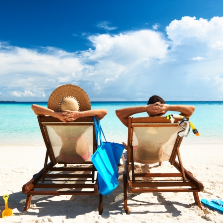 Couple on a tropical beach at Maldives Stock Photo - 18162955