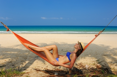 Woman in hammock on tropical beach at Tioman island, Malaysia photo