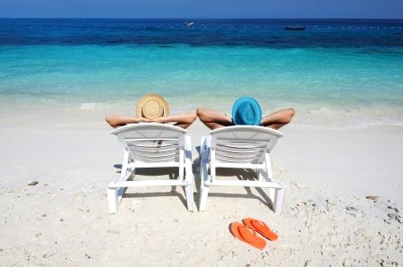 Couple on a tropical beach Stock Photo - 18299921