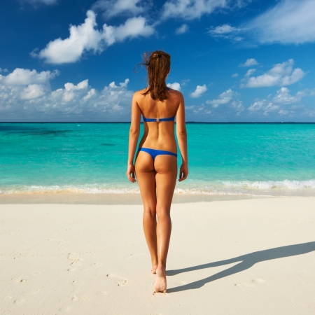 thong woman: Woman in bikini at tropical beach Stock Photo