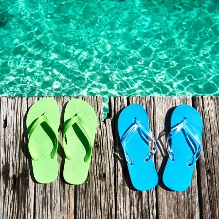 Slippers at jetty by the sea Stock Photo - 18593152