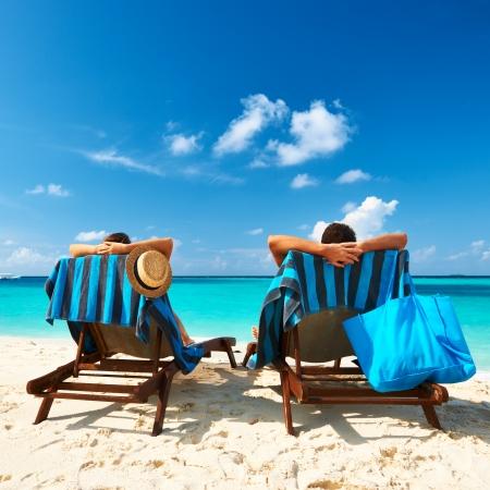 beach chair: Couple on a tropical beach at Maldives