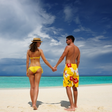 Couple on a tropical beach at Maldives Stock Photo - 18737938