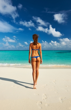 Woman in bikini at tropical beach photo